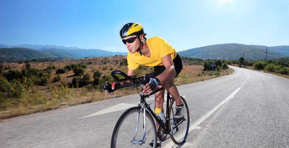 Cyclist riding a bike on an open road in Macedonia credit Ljupco Smokovski